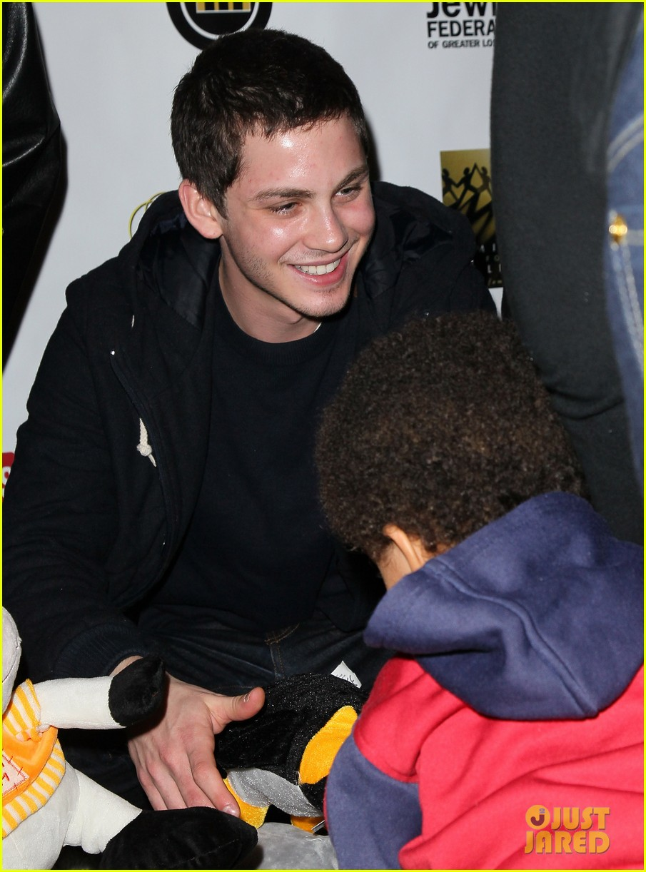 logan lerman working dreams toy drive 02