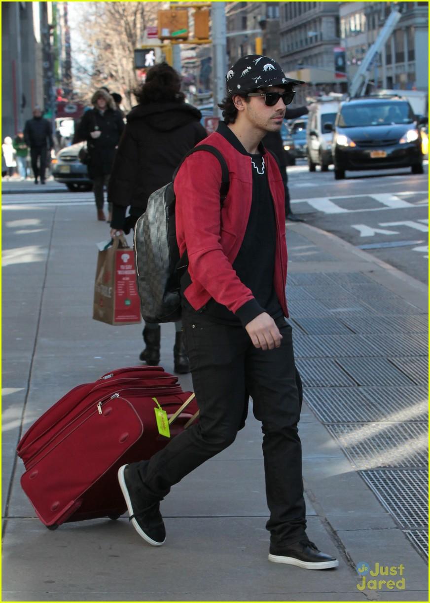 nick joe jonas off to airport 01