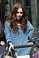 lily collins pushes stroller on love rosie set 02