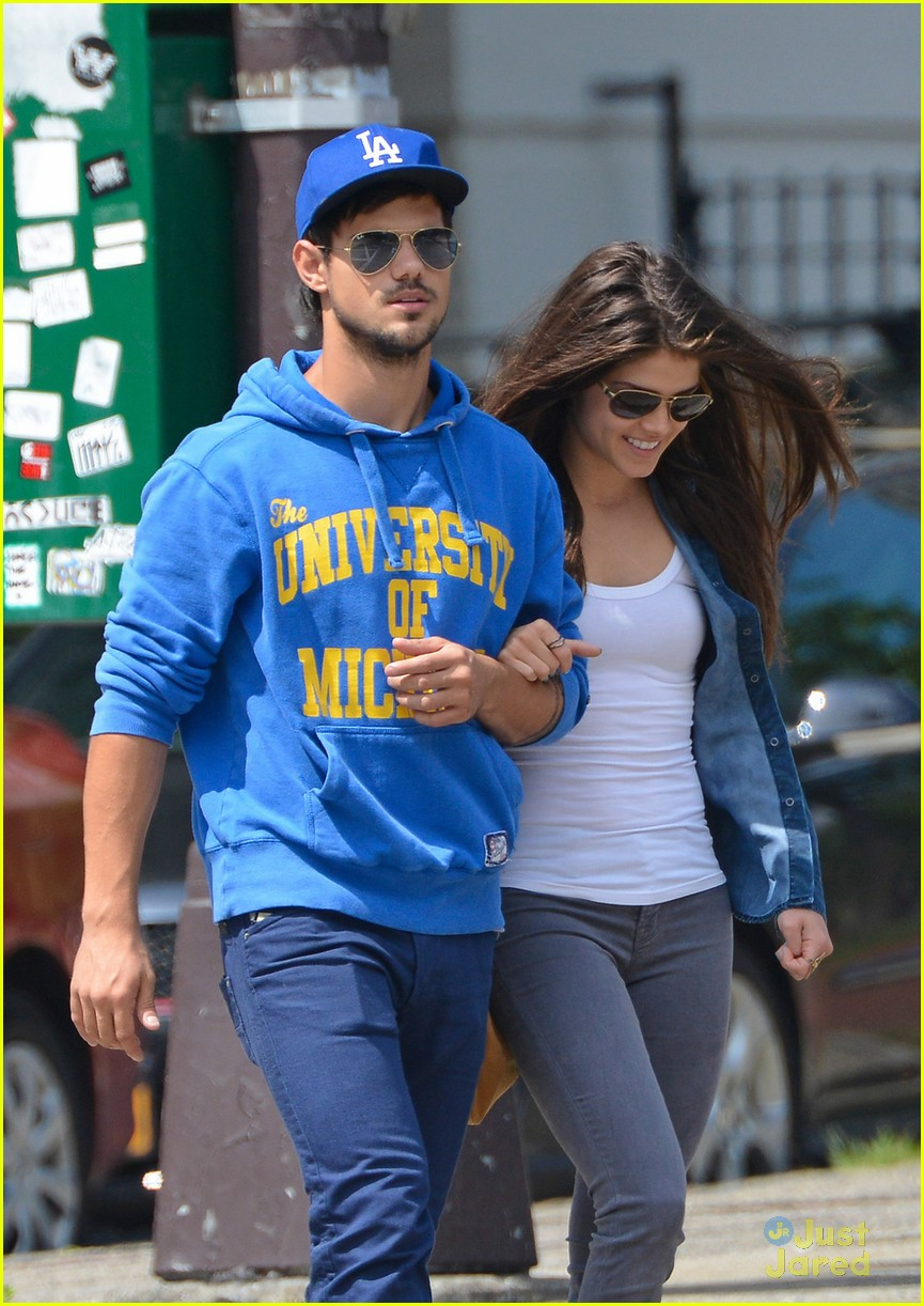 taylor lautner marie avgeropoulos holding hands soho 04