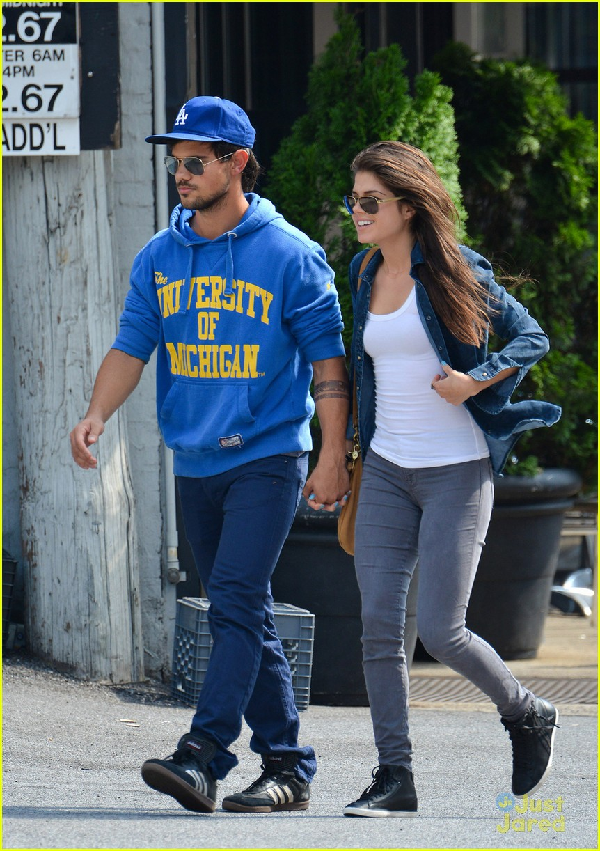 taylor lautner marie avgeropoulos holding hands soho 05