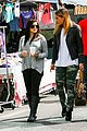 ariel winter makes a furry friend at the farmers market 02