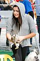 ariel winter makes a furry friend at the farmers market 11