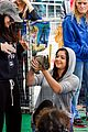 ariel winter makes a furry friend at the farmers market 25