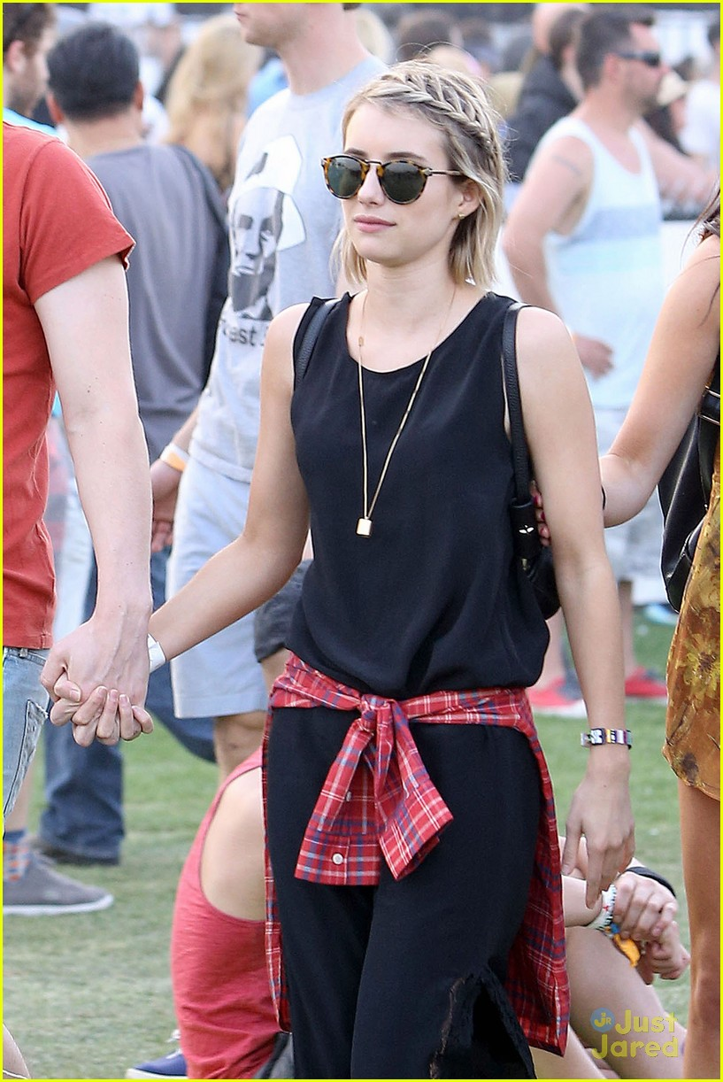 emma roberts and evan peters hold hands at coachella 201413