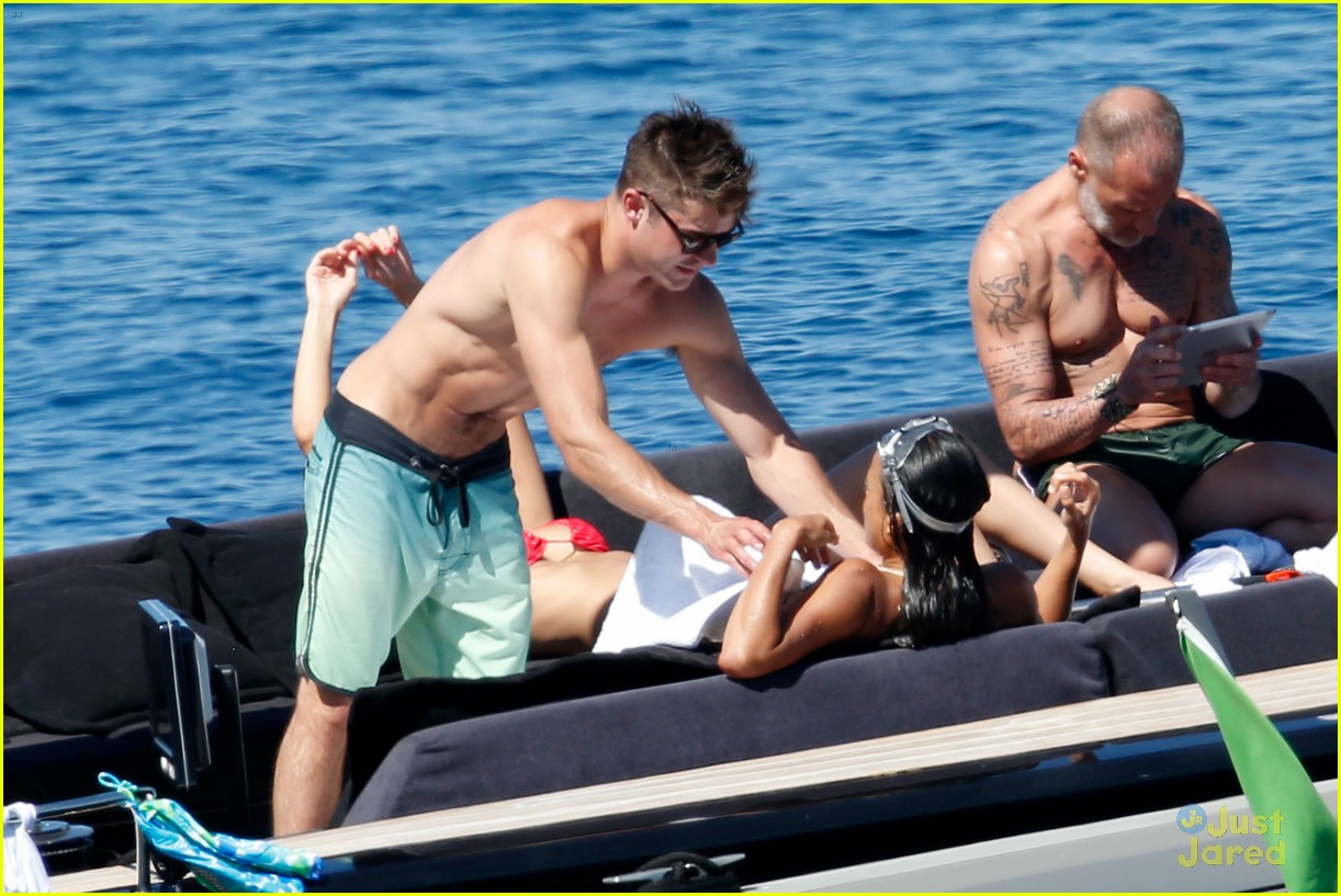 zac efron michelle rodriguez kissing photos 01