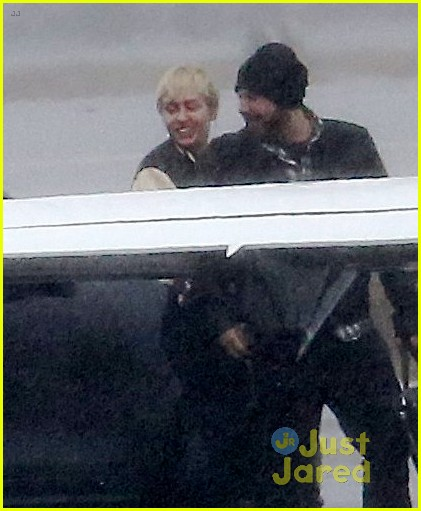 miley cyrus patrick schwarzenegger on private jet 02