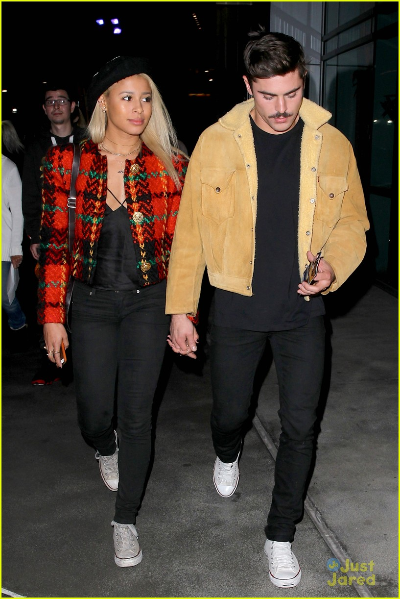 zac efron sami miro hold hands at lakers game date 03