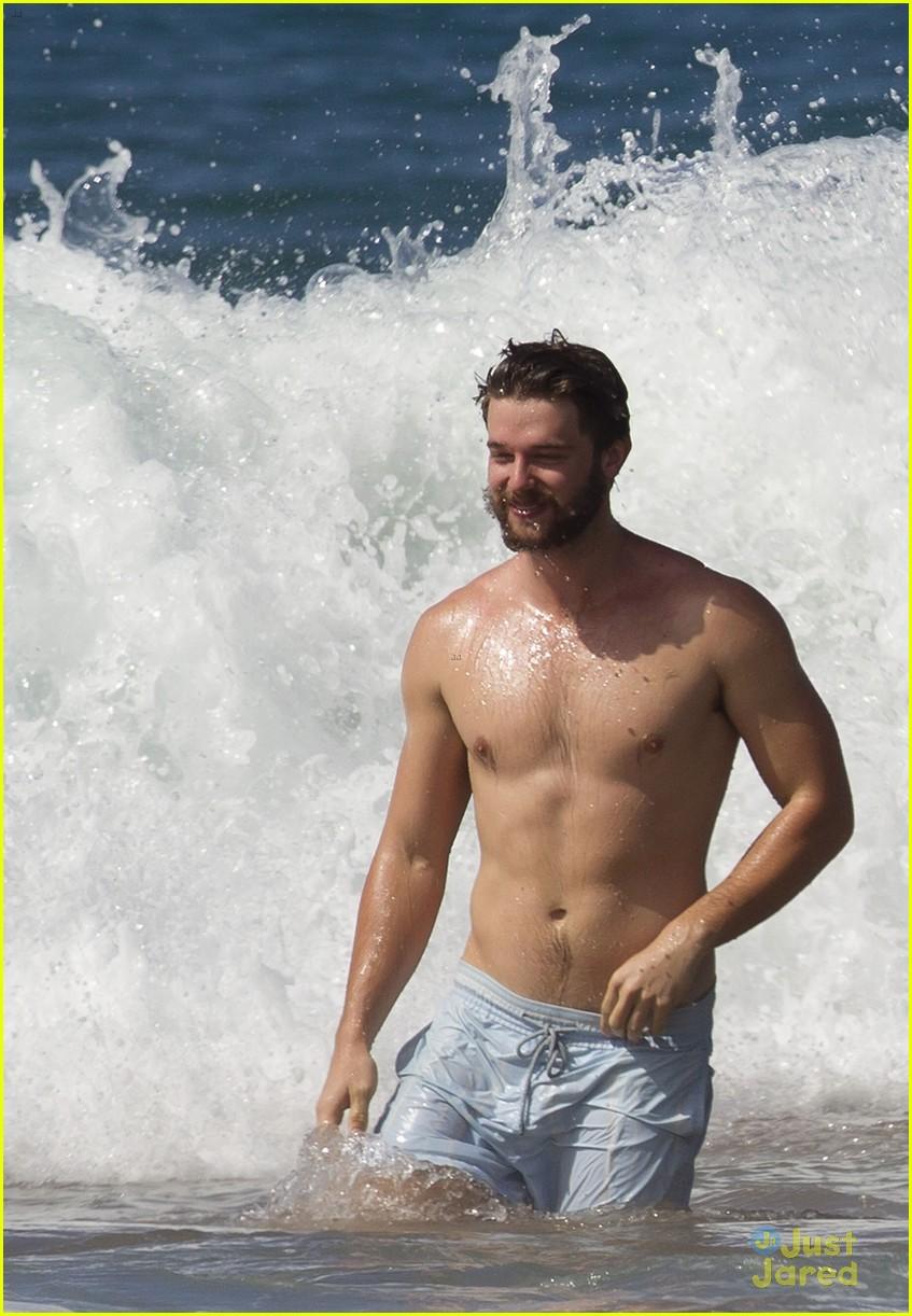 Patrick Schwarzenegger showers bikini-clad Miley Cyrus