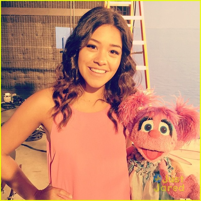 Gina Rodriguez Steals Kisses From Sesame Street's Elmo