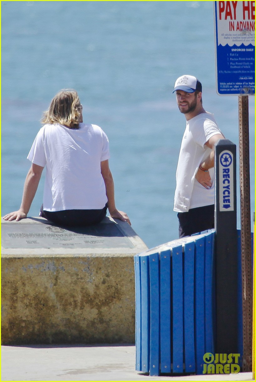 liam hemsworth wetsuit for surfing 06