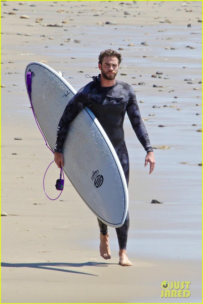 liam hemsworth wetsuit for surfing 10
