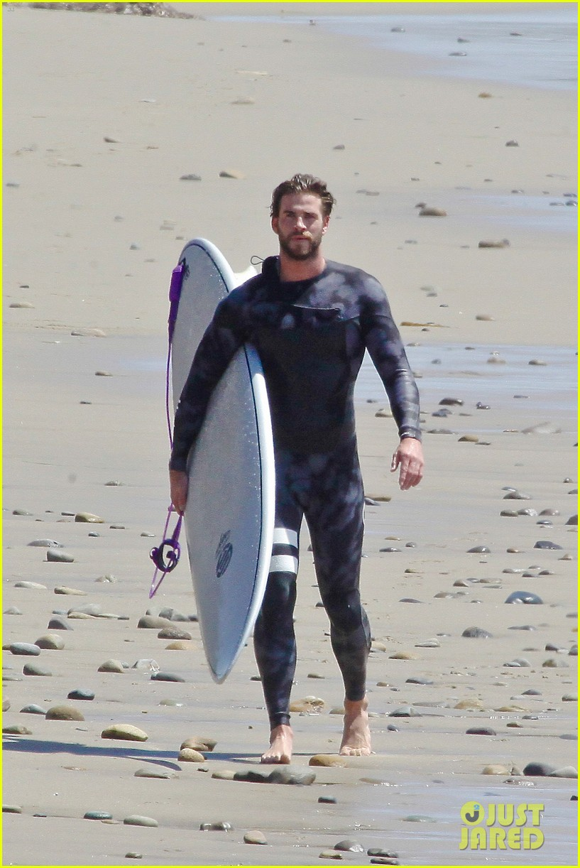 liam hemsworth wetsuit for surfing 17