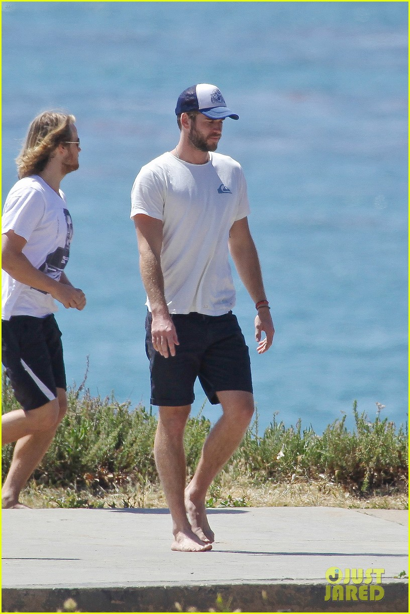 liam hemsworth wetsuit for surfing 18