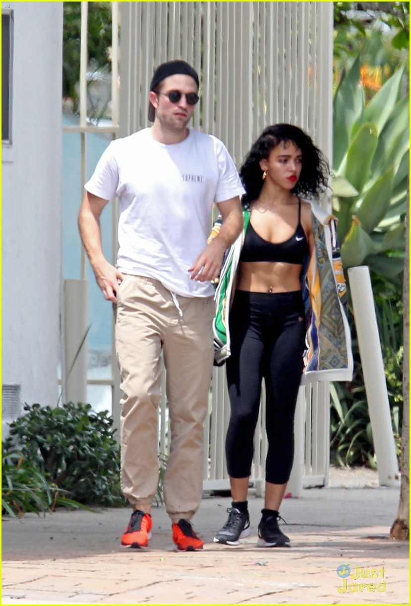 robert pattinson beaming with fka twigs by his side 01
