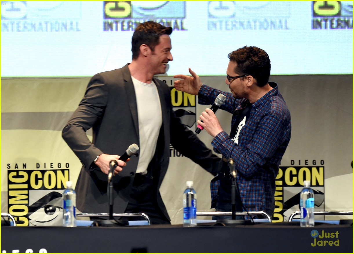 jennifer lawrence hugh jackman embrace at x men comic con panel 16
