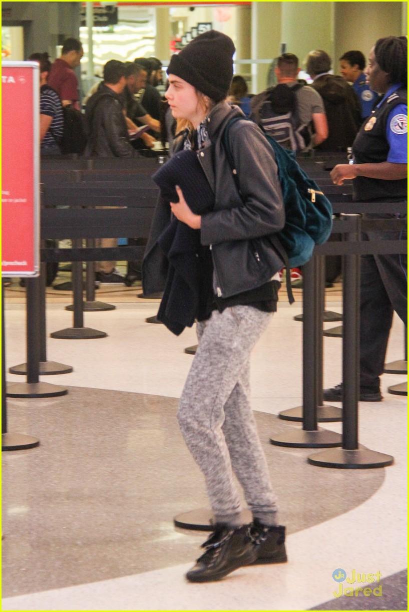 cara delevingne rihanna joins valerian airport arrival 15