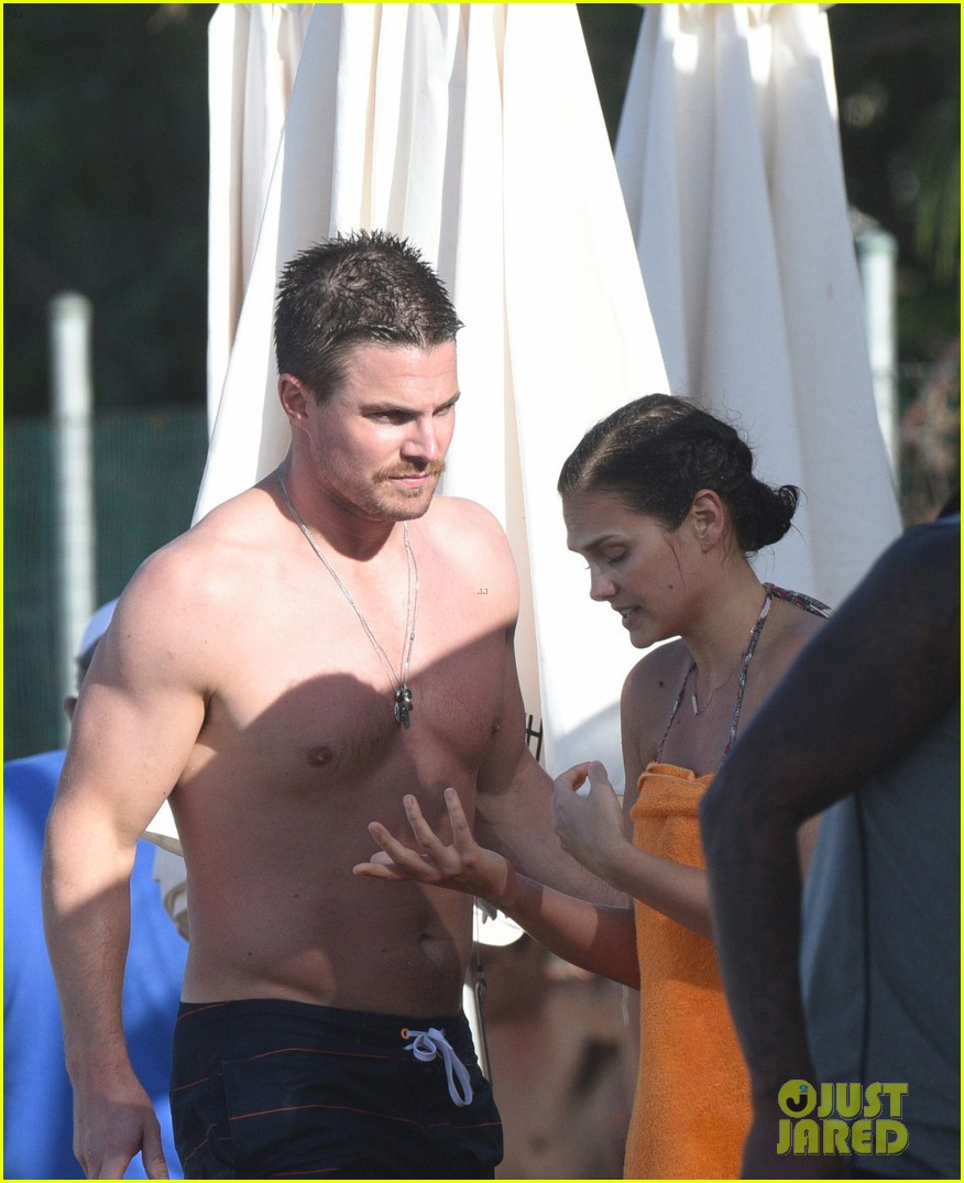 Stephen Amell Runs Through the Waves in St. Barts | Photo ...