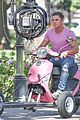zac efron the rock film baywatch on a scooter 40