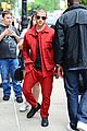 nick jonas red suit aol build appearance 09