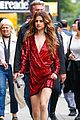 selena gomez frollicks through fountains with young fans 03