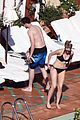 nicholas hoult shirtless by the pool 05