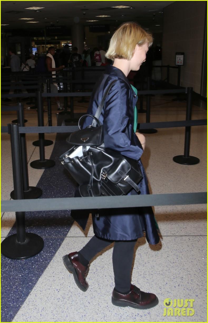 mia wasikowska joins robert pattinson as she arrives at lax airport 02