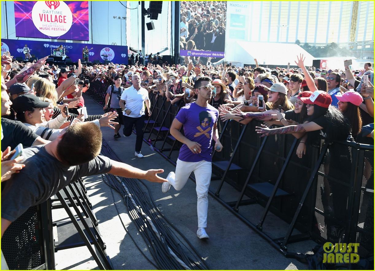Joe Jonas & DNCE Pose With Puppies at iHeartRadio's Daytime