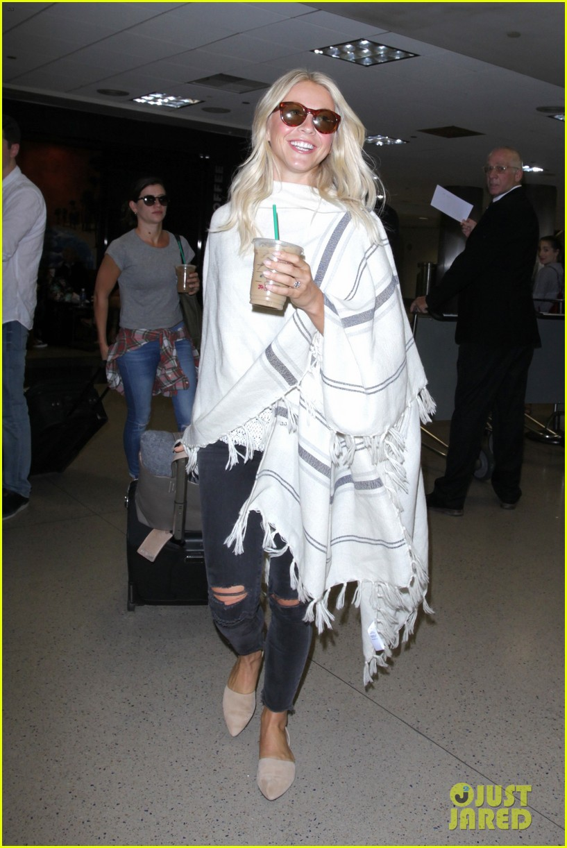 julianne hough grabs an iced coffee after arriving at lax airport 07
