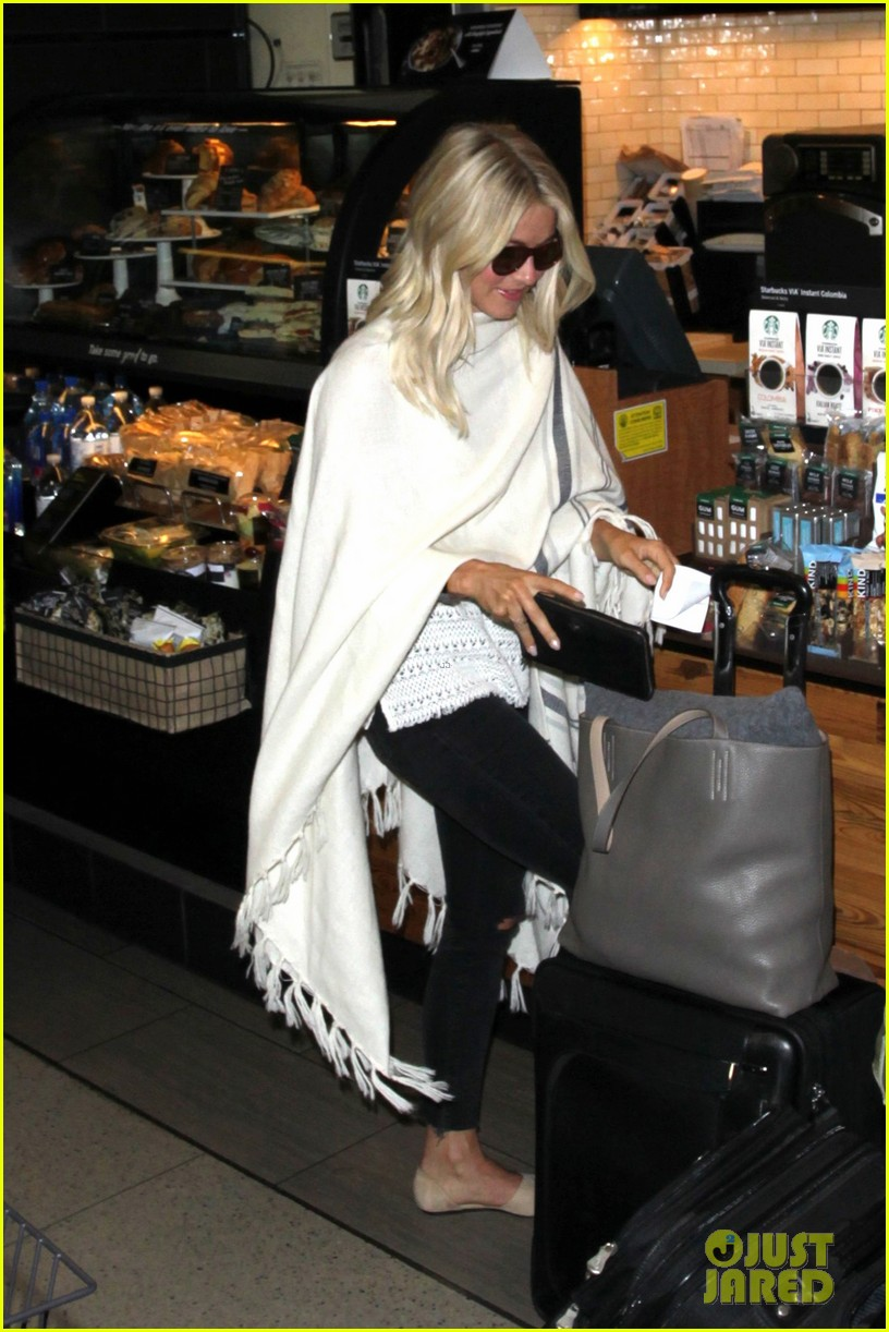 julianne hough grabs an iced coffee after arriving at lax airport 08