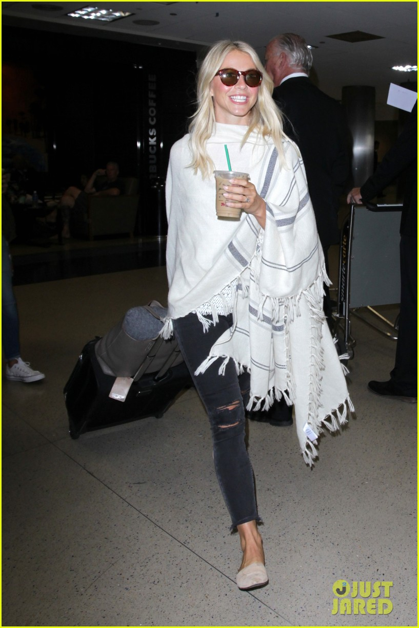 julianne hough grabs an iced coffee after arriving at lax airport 09