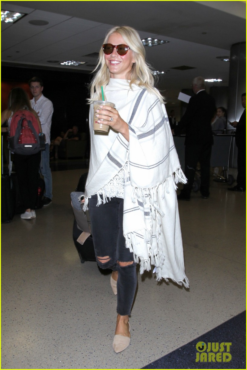 julianne hough grabs an iced coffee after arriving at lax airport 10