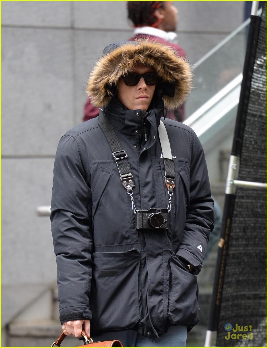 a2c1b054e72 Rupert Grint Hides Under A Hooded Jacket on  Snatch  Set