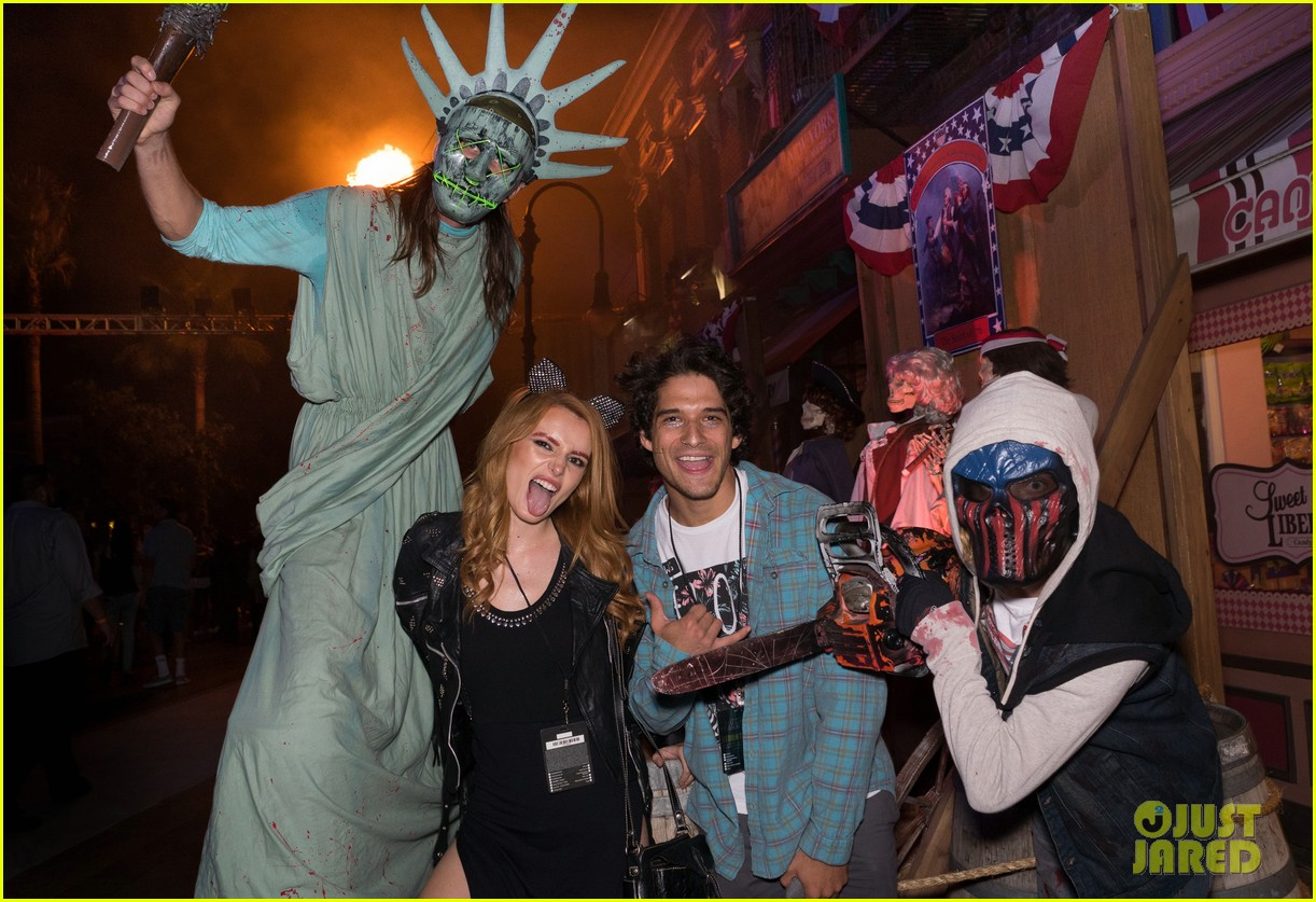 bella thorne tyler posey couple up at halloween horror nights 01