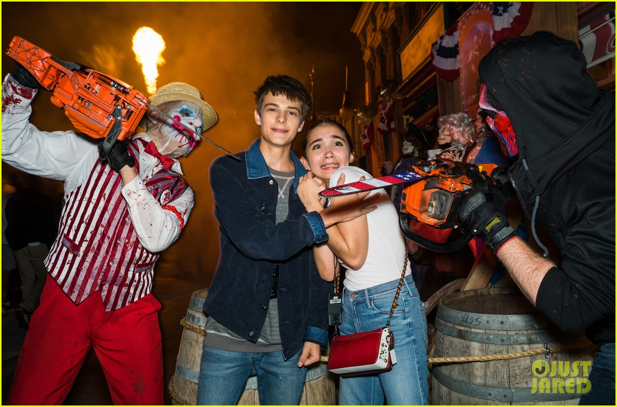 bella thorne tyler posey couple up at halloween horror nights 03