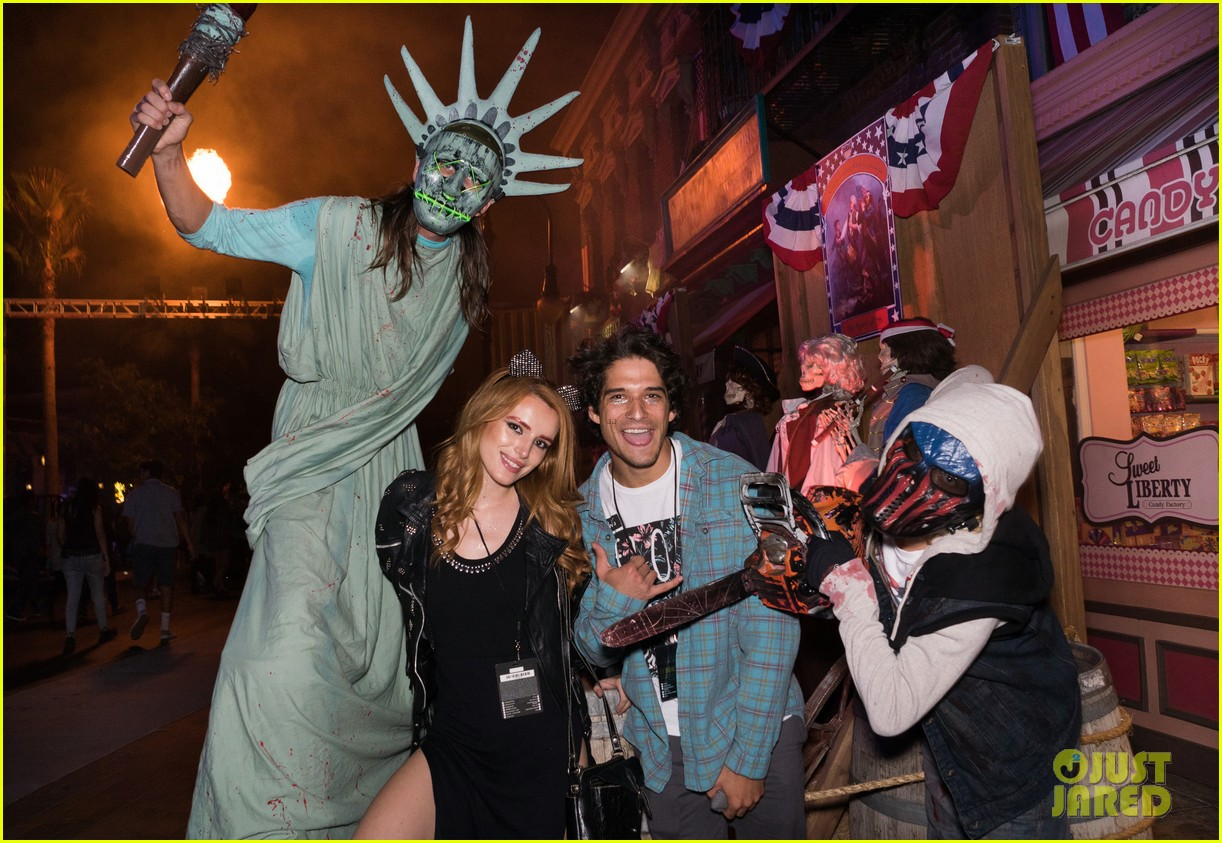 bella thorne tyler posey couple up at halloween horror nights 07