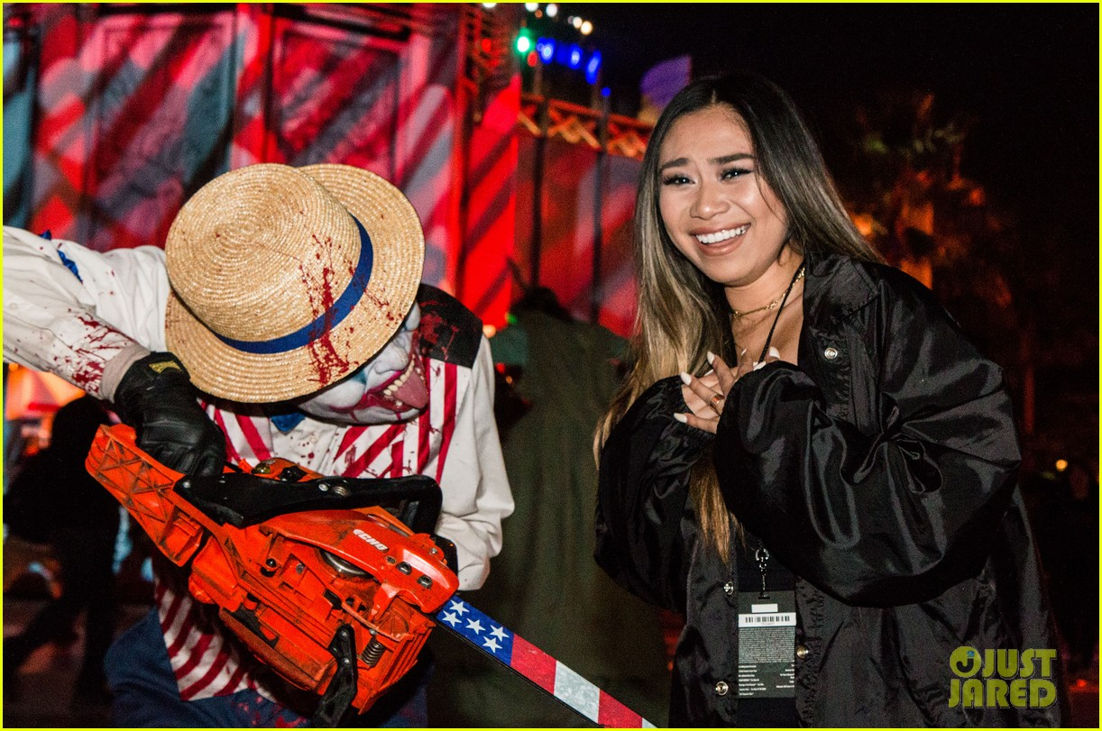 bella thorne tyler posey couple up at halloween horror nights 12