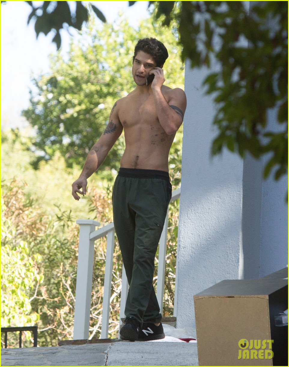 tyler posey goes shirtless as he works on his motorcycle 07