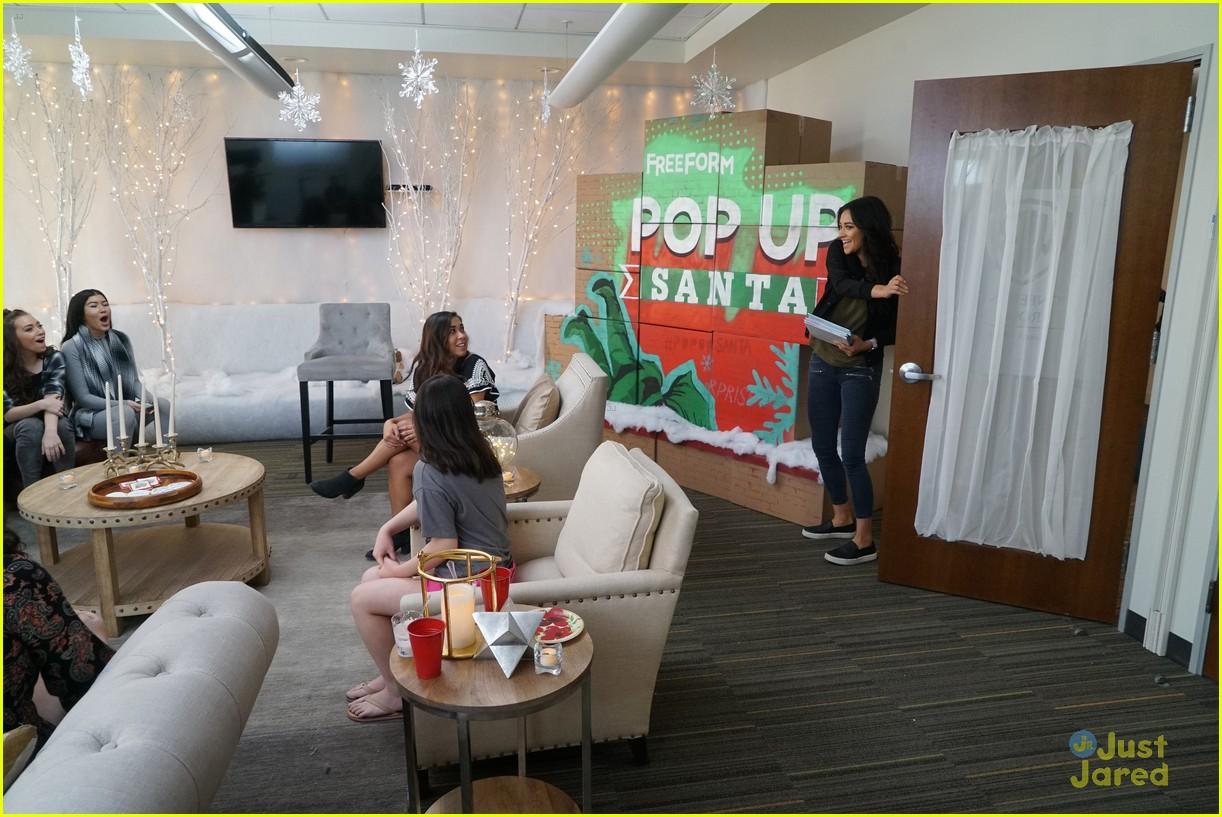 shay mitchell tahj mowry freeform stars pop up santa 07