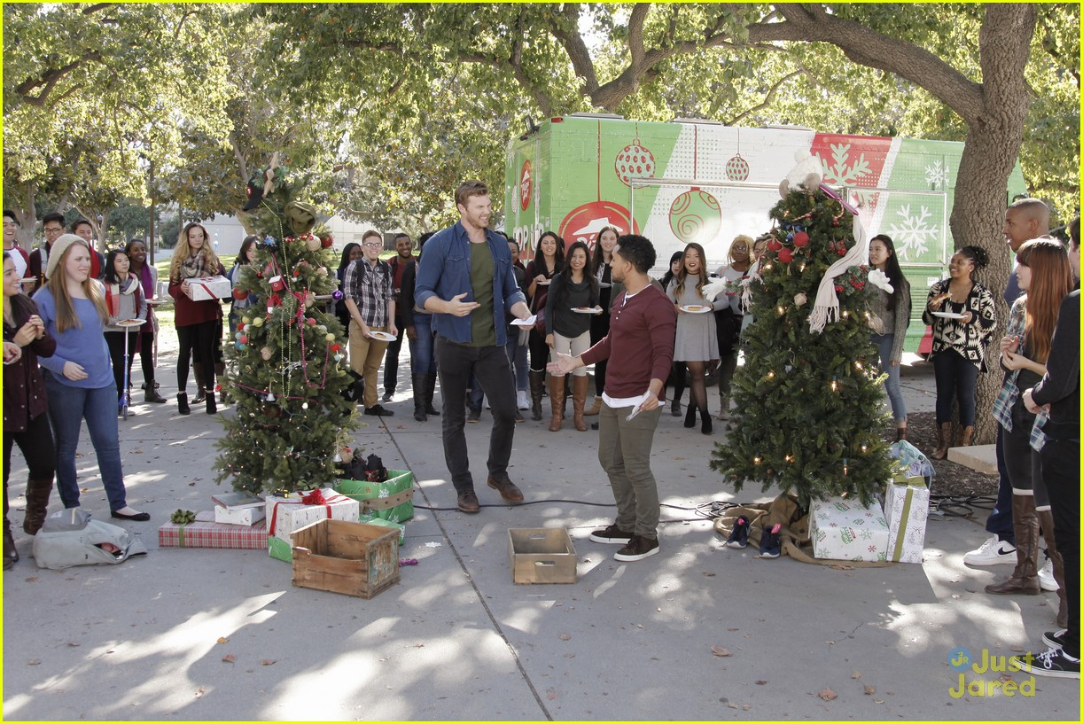 shay mitchell tahj mowry freeform stars pop up santa 12