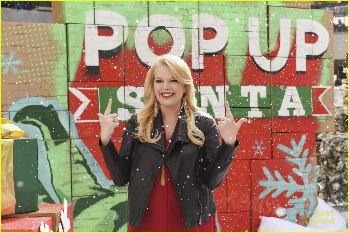 shay mitchell tahj mowry freeform stars pop up santa 16