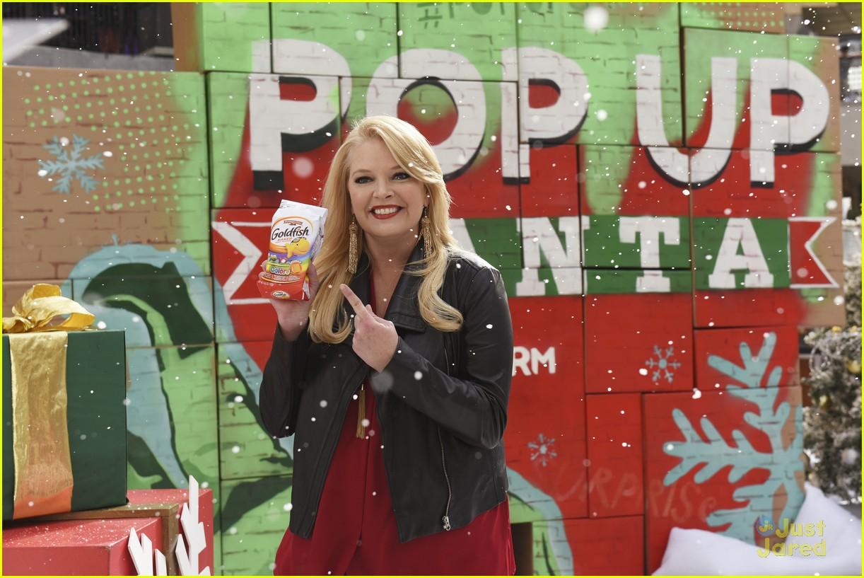 shay mitchell tahj mowry freeform stars pop up santa 17