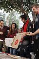 shay mitchell tahj mowry freeform stars pop up santa 05