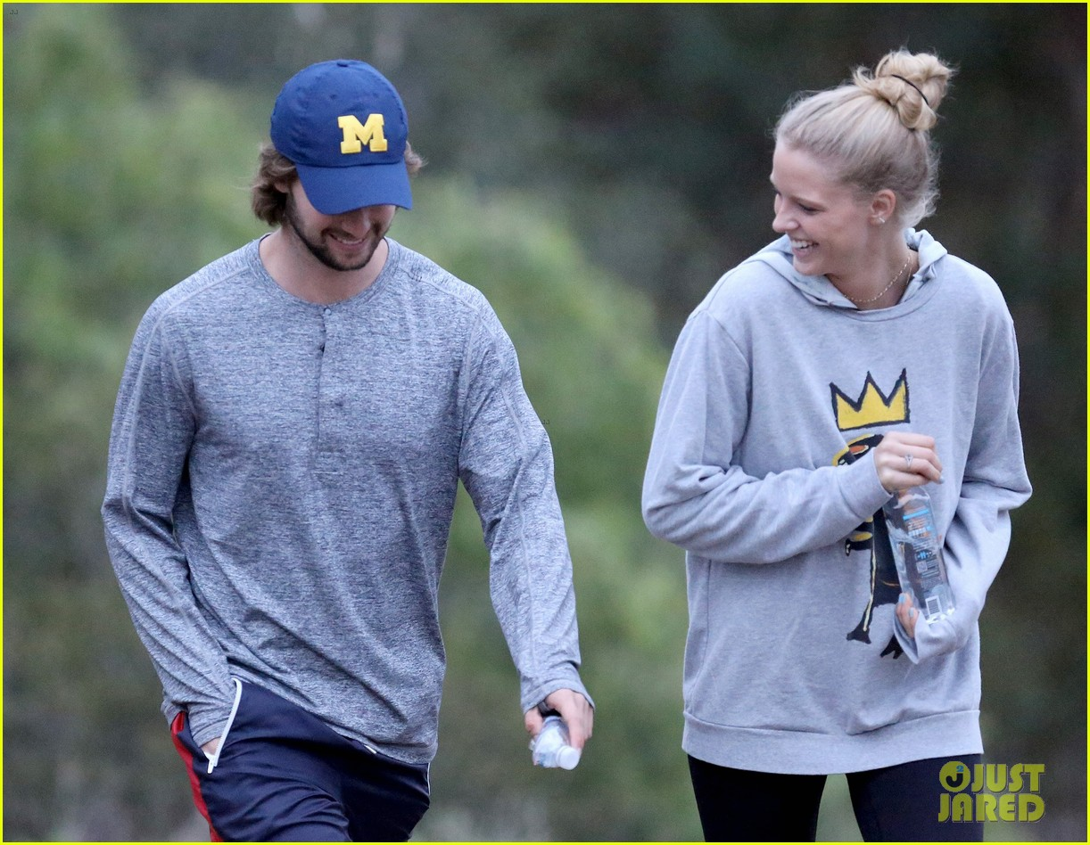 patrick schwarzenegger and abby champion cuddle on the beach together 01
