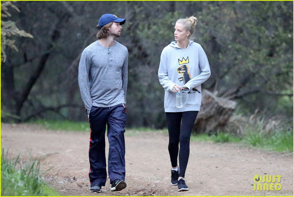 patrick schwarzenegger and abby champion cuddle on the beach together 07