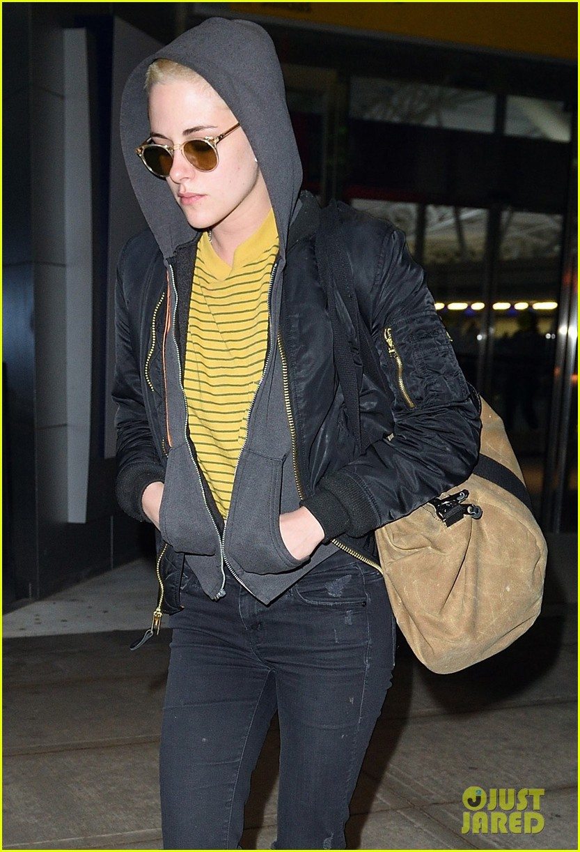 kristen stewart covers up new buzzed hair arriving in nyc 02