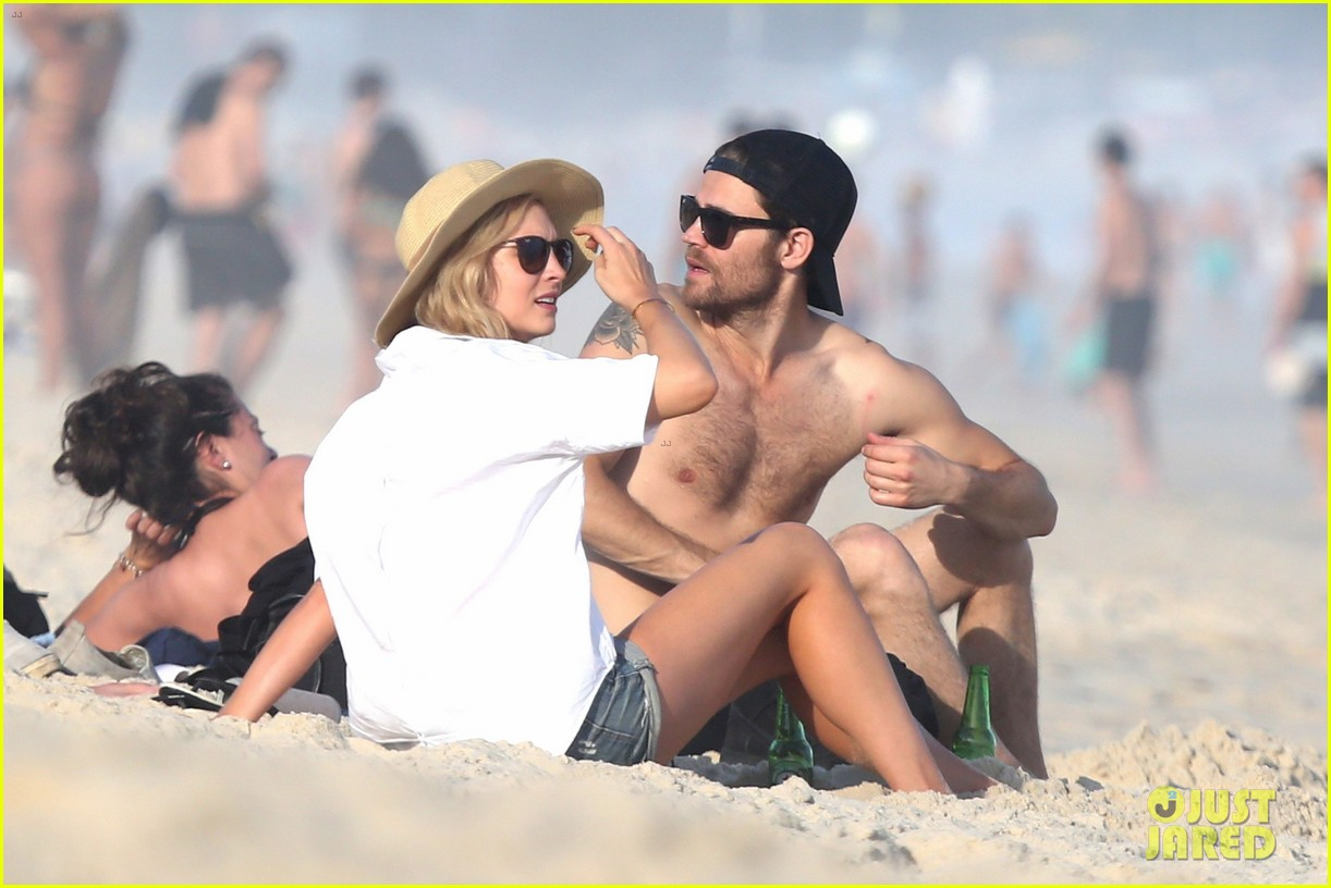 paul wesley candice king hit the beach in rio 01