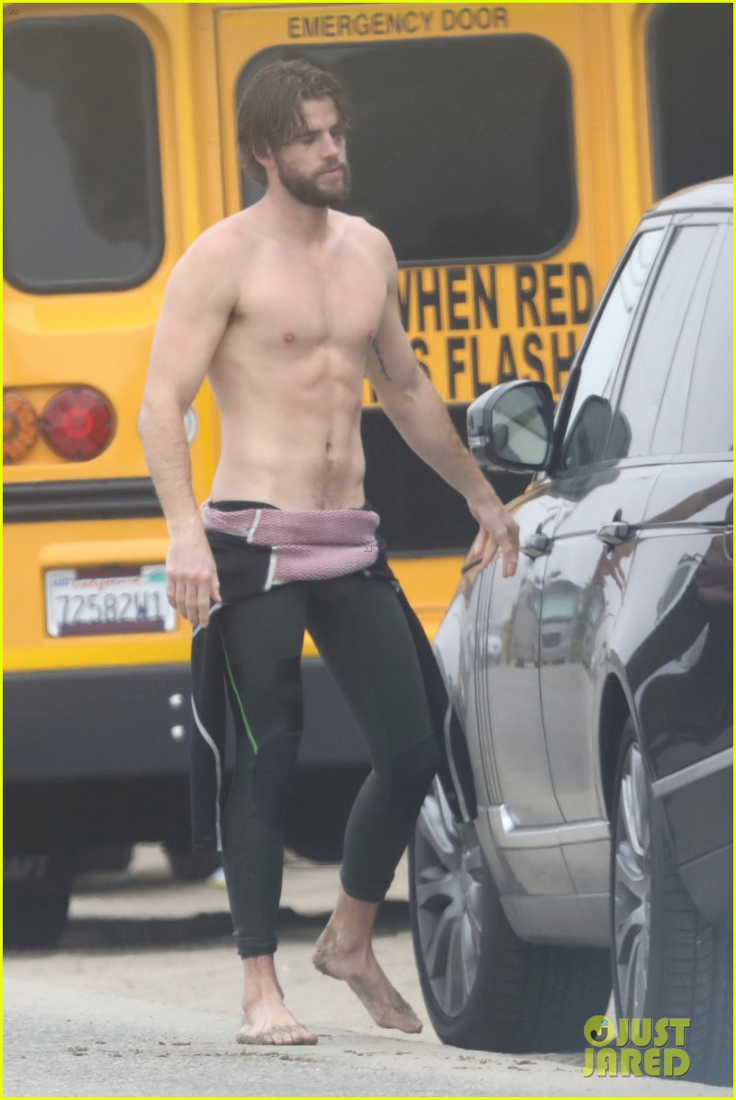 liam hemsworth strips out of wetsuit to reveal ripped abs 03