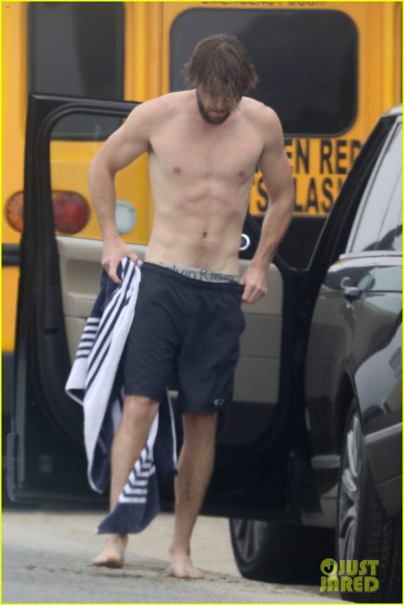 liam hemsworth strips out of wetsuit to reveal ripped abs 54