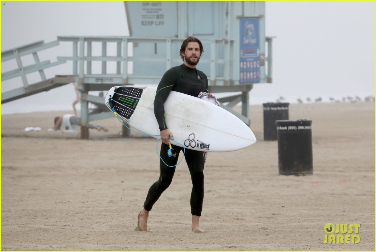 liam hemsworth strips out of wetsuit to reveal ripped abs 72